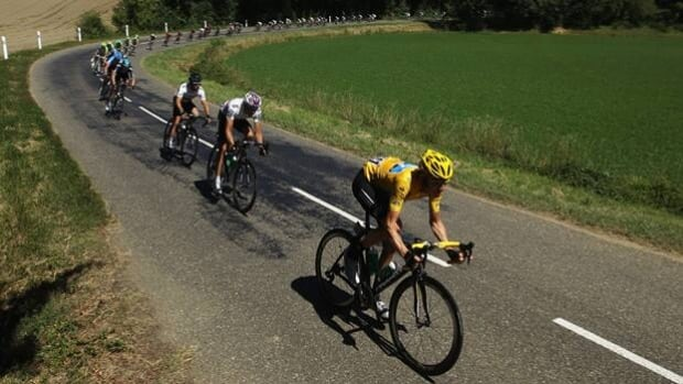 Bradley Wiggins, in yellow, remains the overall leader heading into a rest day on Tuesday.