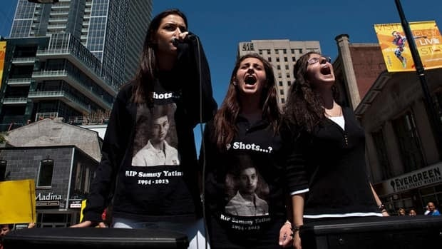 Public outcry over the shooting of Sammy Yatim may have played a role in the murder charge against Const. James Forcillo. Yatim's sister Sarah, middle, and her friends lead a protest march to Toronto police headquarters on Aug. 13.