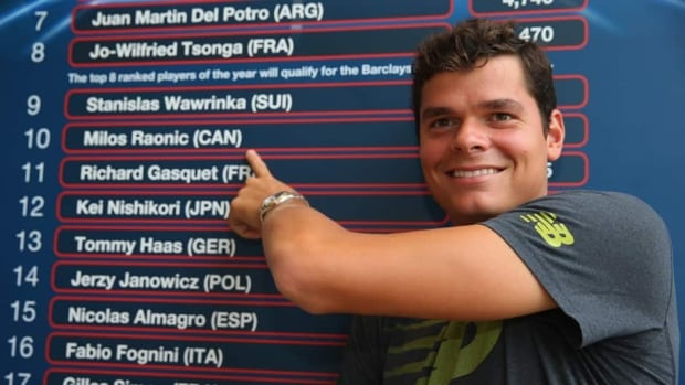 Milos Raonic in front of the ATP ranking board during the Western & Southern Open on August 12, 2013 at Lindner Family Tennis Center in Cincinnati, Ohio.