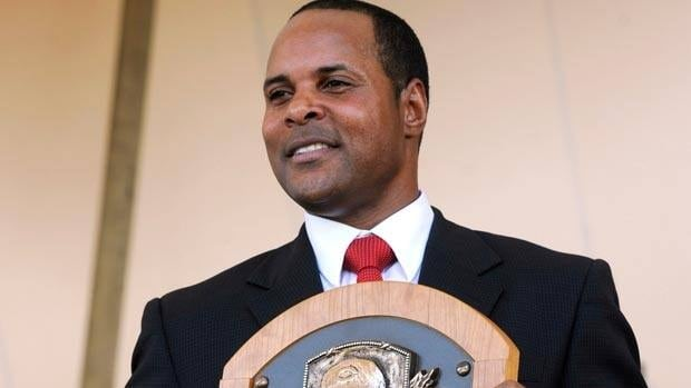 Former Cincinnati Reds great Barry Larkin poses with his plaque after induction on Sunday.
