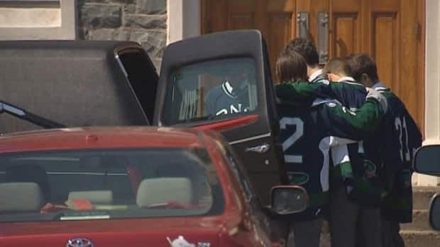 Friends wear their hockey jerseys to honour Boyd.