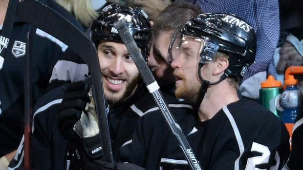 Dwight King, left, celebrates with Los Angeles Kings teammate Trevor Lewis after his third period goal against the Phoenix Coyotes in Game 3.