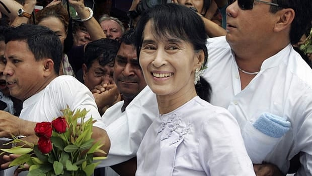 Burma pro-democracy leader Aung San Suu Kyi, centre, arrives at the headquarters of her National League for Democracy party in Rangoon on Monday. Suu Kyi said she hopes her victory in a landmark election will mark the beginning of a new era for Burma.