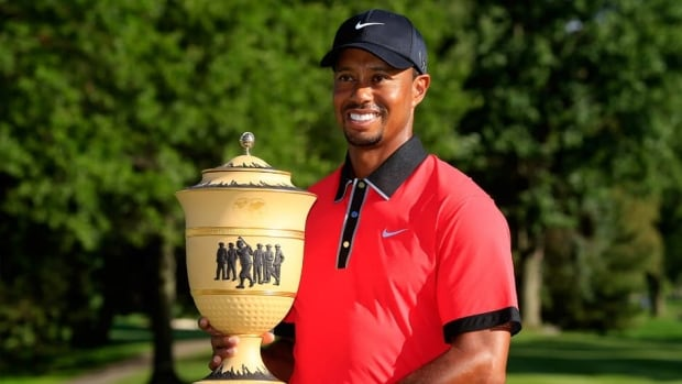 Tiger Woods holds trophy after the final round of the Bridgestone Invitational at Firestone Country Club South Course on August 4, 2013 in Akron, Ohio.