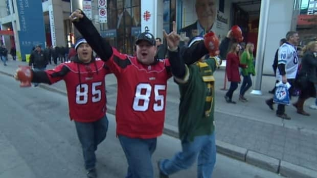 Calgary Stampeder fans party on the streets of Toronto before Sunday's big game.