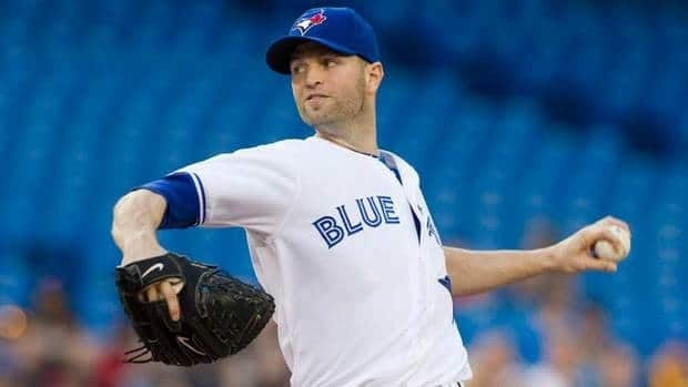 Toronto Blue Jays starting pitcher J.A. Happ works against Texas Rangers during the second inning AL baseball action in Toronto on Friday.
