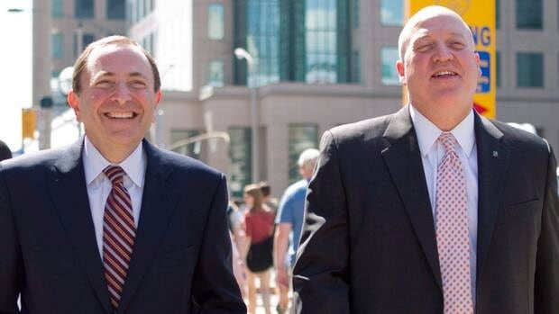NHL commissioner Gary Bettman, left, and Bill Daly, the NHL's deputy commissioner, are shown in this August 2012 file photo leaving meetings in Toronto.