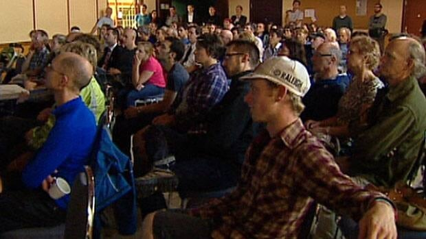 About 100 cyclists met at a town hall meeting Tuesday night to improve safety around the Whyte Avenue area.