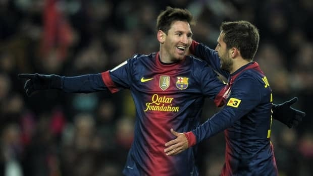 Barcelona's Lionel Messi, left, celebrates with teammate Jordi Alba after scoring against Athletic Bilbao at the Camp Nou stadium in Barcelona.