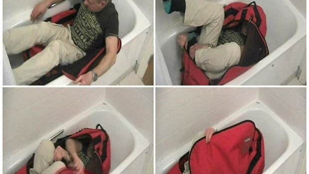 A combination of still photographs taken from video shows a man trying to lock himself in a sports bag in this undated image provided by the Metropolitan Police. The video was shown at the inquest into the death of MI-6 officer Gareth Williams, who was found dead in his apartment locked in a similar bag.