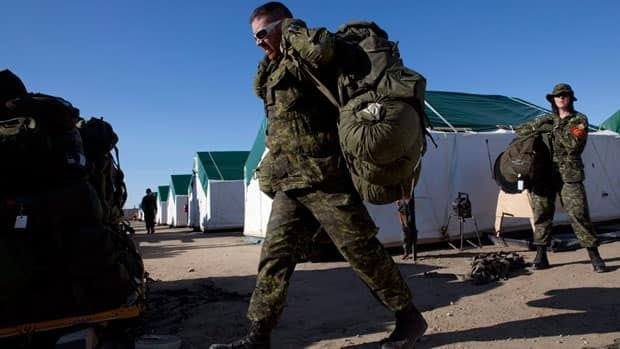 Canadian soldiers pack gear onto skids during Operation Nanook in Resolute, Nunavut, in  August 2010.