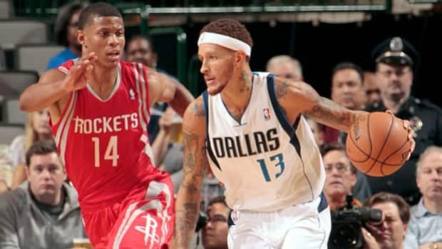 Delonte West (13) of the Dallas Mavericks handles the ball against Scott Machado of the Houston Rockets on Oct. 15, 2012 at the American Airlines Center in Dallas, Texas.