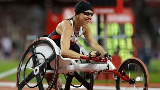 Canada's Michelle Stilwell celebrates after winning the women's 200m T52 final race at the 2012 Paralympics in London, Saturday.
