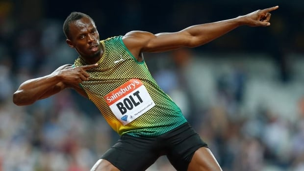 Usain Bolt celebrates after winning the men's 100-metre race during the London Diamond League 'Anniversary Games' on Friday.