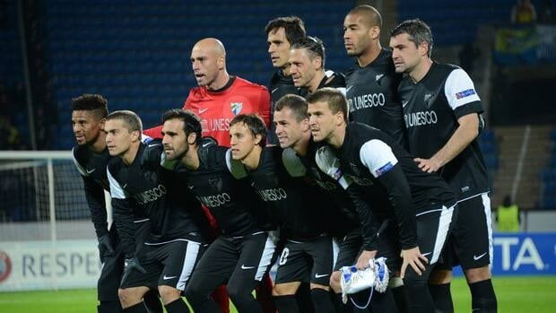 Malaga players pose for a photo before a Champions league match against Zenit, on November 21, 2012.