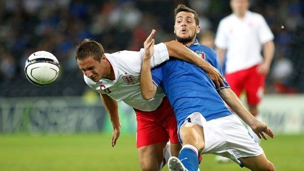 England's Phil Jagielka, left, fights for the ball with Italy's Mattia Destro, right, during Wednesday's match in Bern, Switzerland. (AP Photo/Keystone, Salvatore Di Nolfi)