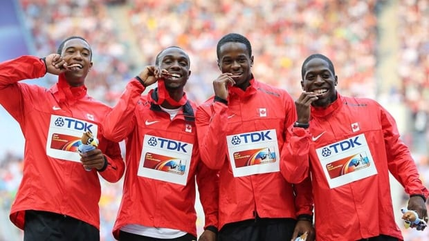 Canada's bronze medalists Gavin Smellie, Aaron Brown, Dontae Richards-Kwok and Justyn Warner pose on the podium during the men's 4x100 metres relay final at the 2013 IAAF World Championships at the Luzhniki stadium in Moscow on Sunday.