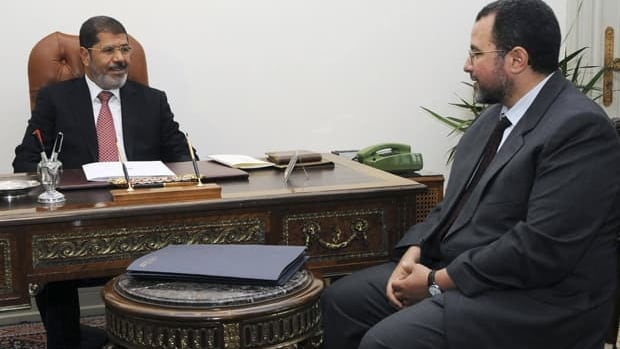 Egyptian President Mohammed Morsi, left, meets with  Hesham Kandil at the presidential palace in Cairo on Sunday. Morsi named Hesham Kandil prime minister designate on Tuesday and tasked him with putting together a new cabinet to replace the current military-appointed one.