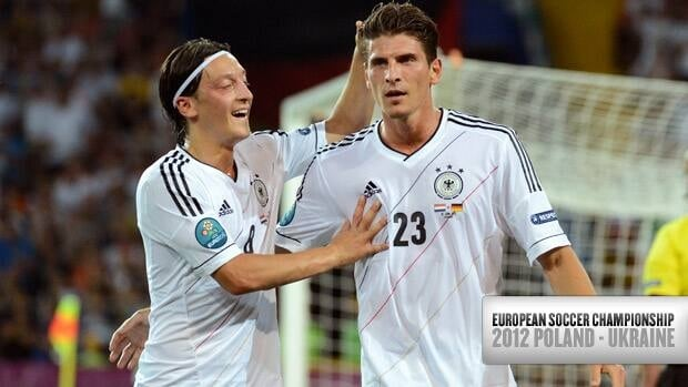 Germany's Mario Gomez, right, celebrates one of two goals with teammate Mesut Oezil Wednesday against the Netherlands at the European championship in Kharkiv, Ukraine.