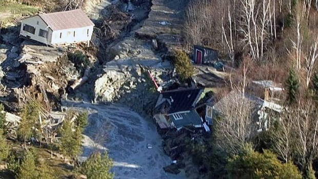 Houses collapse into a crater caused by record rainfall over a 24-hour period just south of Wawa, Ont.