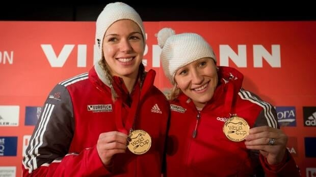 Canada's Chelsea Valois, left, and Kaillie Humphries, right, show off their medals after winning the women's bobsled World Cup event in Whistler, B.C., on Friday November 23, 2012.