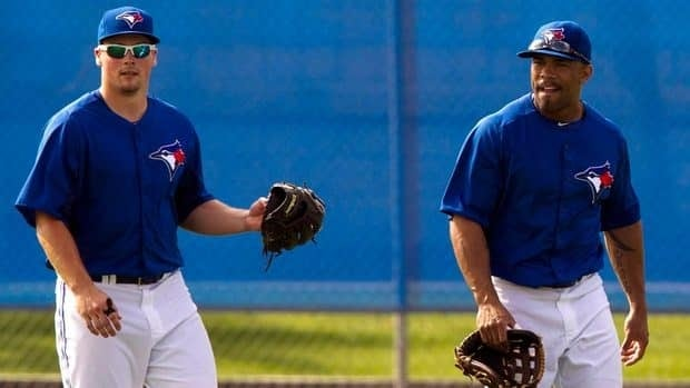 Toronto Blue Jays Travis Snider, left, and Eric Thames walk in from the outfield after a drill during Spring Training in Dunedin, Fla. on Thursday March 1, 2012.