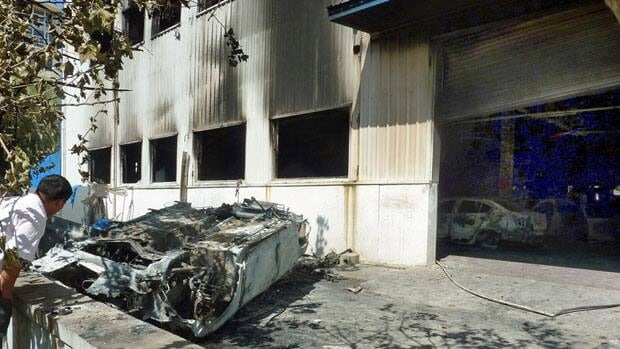 Anti-Japan demonstrations left a burnt car and a scorched Japanese auto dealership in Qingdao, China, last month. Sales of Toyota and Honda vehicles have nosedived in China as a diplomatic row threatens to hobble what was a booming business relationship between Japan and its biggest export market.