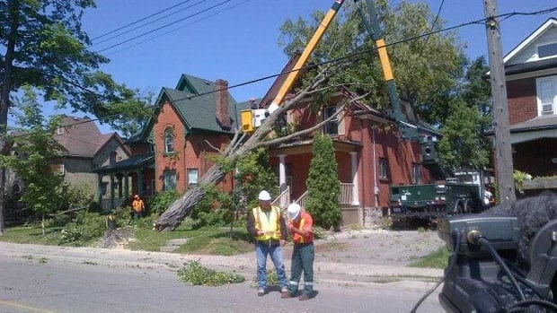 A tree toppled into a home near the intersection of Duke and Wellington streets in Kitchener after a storm hit Saturday night.