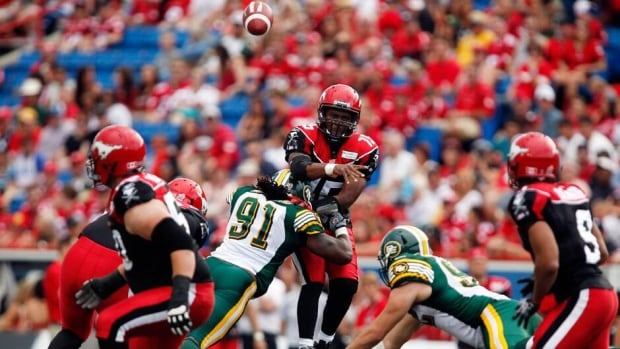 "Calgary Stampeders head coach John Hufnagel, not shown, said that quarterback Kevin Glenn, centre, ""could have played"" the rest of the game if necessary but with less mobility."