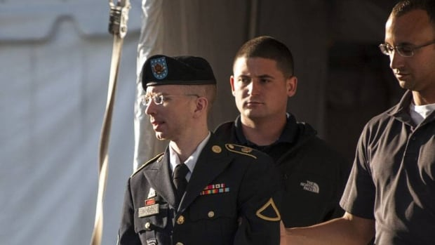 Pte. 1st Class Bradley Manning is escorted out of court after testifying in the sentencing phase of his military trial at Fort Meade, Md. His sister testified about their troubled childhood while counsellors spoke about his mental health.