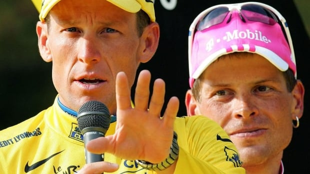 Former cyclist Jan Ullrich, right, would like to see Lance Armstrong, left, have all seven of his Tour de France victories reinstated.