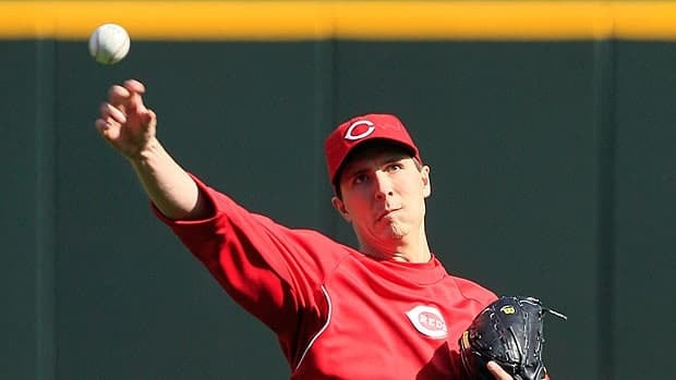 Cincinnati Reds pitcher Homer Bailey long tosses during a workout Monday ahead of his big assignment in Game 3.