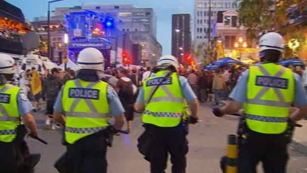 Police block the approach to downtown Montreal's Crescent Street, where a Grand Prix street party was taking place Friday night.
