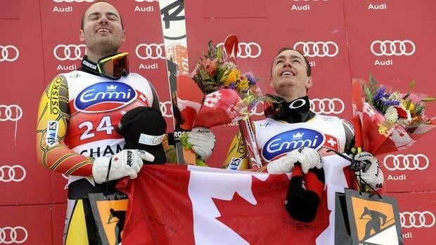 Canada's Jan Hudec, left, celebrates on the podium with third placed fellow-countryman Erik Guay, after winning an alpine ski, men's World Cup downhill, in Chamonix, France on Saturday.