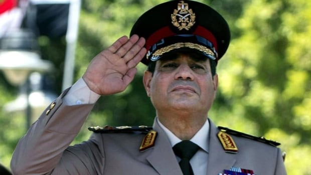 Egyptian Defense Minister Gen. Abdel-Fattah el-Sissi salutes during an arrival ceremony for U.S. Secretary of Defense Chuck Hagel, at the Ministry of Defense in Cairo. Egypt's military chief on Wednesday called on his countrymen to hold mass demonstrations to voice their support for the army and police.