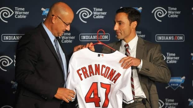 Cleveland Indians general manager Chris Antonetti, right, presents new manager Terry Francona with a his jersey during a news conference on Monday.
