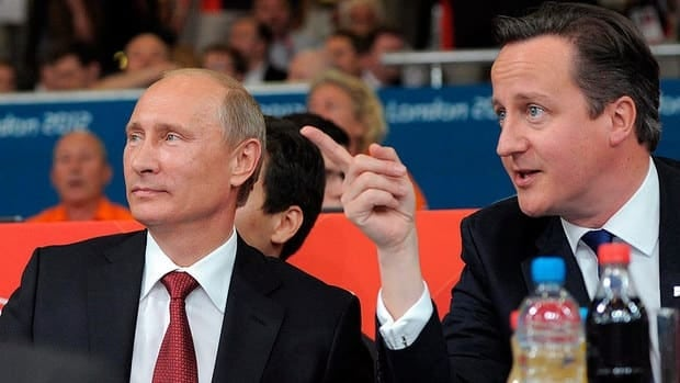 Russian President Vladmir Putin, left and British Prime Minister David Cameron watch judo during the women's 78-kg competition at the 2012 Summer Olympics on Thursday in London.
