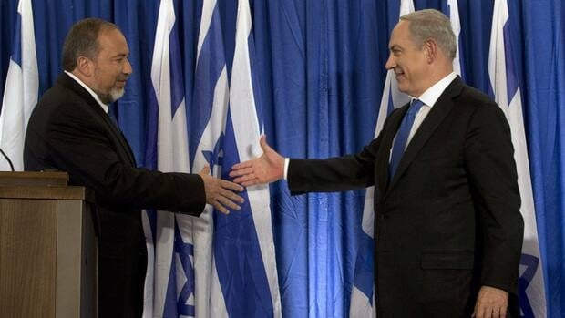 Israeli Prime Minister Benjamin Netanyahu, right, and Israel's Foreign Minister Avigdor Lieberman shake hands in front after giving an statement in Jerusalem on Thursday.