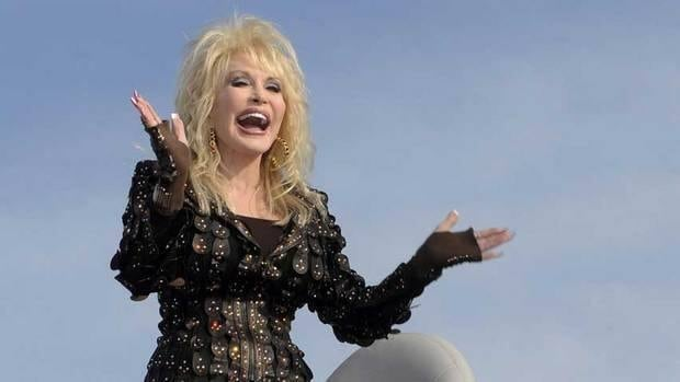 Dolly Parton says her ultra-feminine image was often an advantage, as men tended to underestimate her.