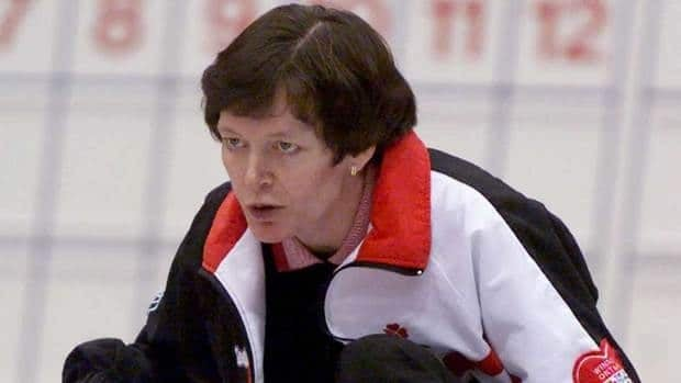 Anne Merklinger, seen at a curling competition in 2000, has been involved with the Own the Podium program for several years.