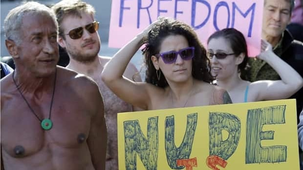 Demonstrators gather outside of city hall in San Francisco for a protest against a proposed citywide nudity ban.