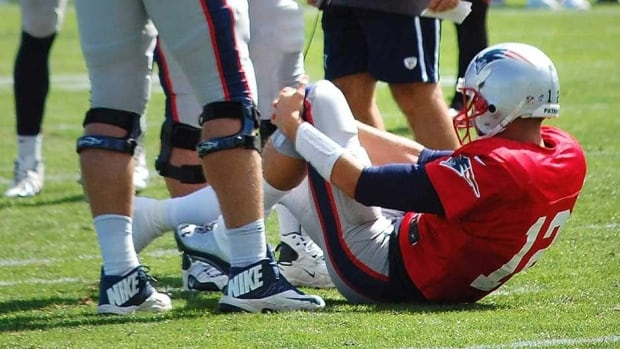 New England Patriots quarterback Tom Brady sprained his left knee on Wednesday at practice.