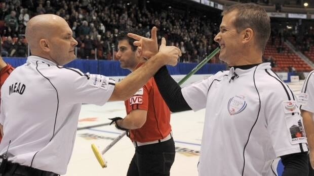 Skip Jeff Stoughton, right, was one of the winners in the first draw of the Canadian Open.