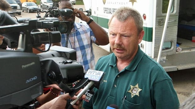Union County Sheriff Jimmy Edwards speaks with the media outside a mobile command centre at East Union School, in Union County, Miss.