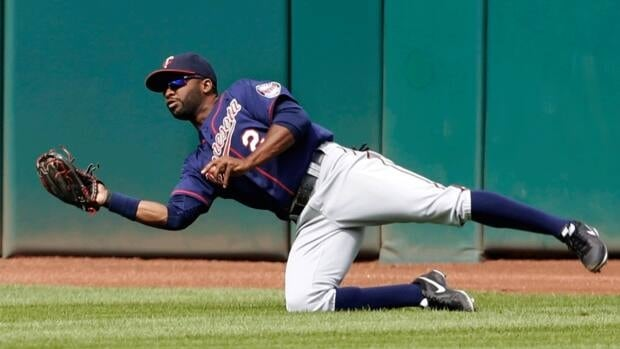 Denard Span, seen here making a diving catch against the Cleveland Indians on Sept. 20, 2012, was acquired by the Washinton Nationals in a trade with the Minnesota Twins on Thursday.