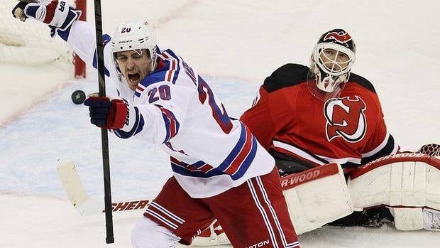 Rangers' Chris Kreider celebrates his third-period goal as Devils goalie Martin Brodeur reacts in Game 3 of the NHL Eastern Conference final.