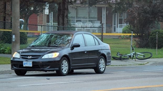 A cyclist was taken to hospital after he was struck by a vehicle on Kennedy Road early Wednesday.