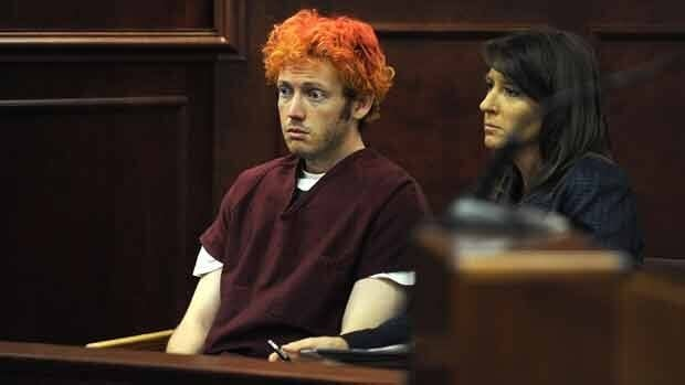 James Holmes (left) sits with public defender Tamara Brady during his first court appearance in Aurora, Colo., last week.