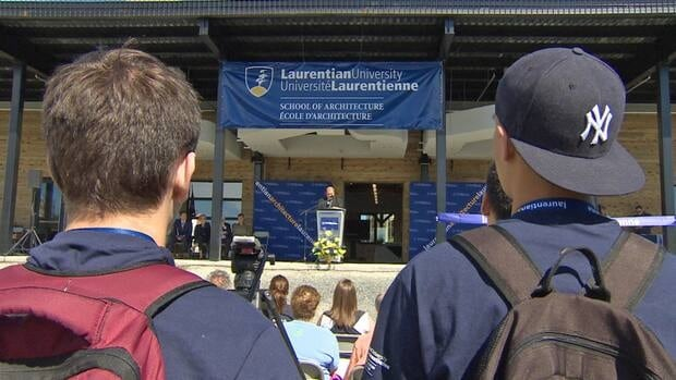 Students look on as Laurentian University's School of Architecture was officially opened on Wednesday afternoon.