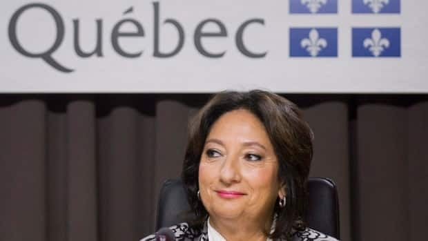 Justice France Charbonneau smiles as she sits on the opening day of a Quebec inquiry looking into allegations of corruption in the province's construction industry in Montreal. The Competition Bureau of Canada says it's keeping tabs on testimony at the ongoing corruption inquiry.